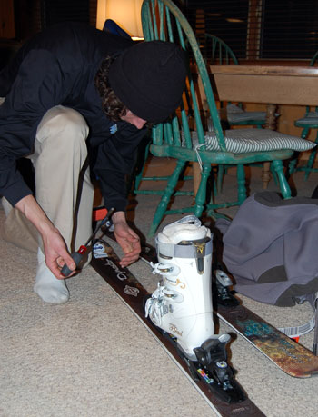 Rental ski bindings being adjusted by Black Tie Ski Rental