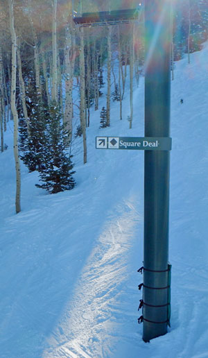 Trail signs face UP the mountain at Deer Valley Ski Resort in Utah - so you can know the trail names from the lift.