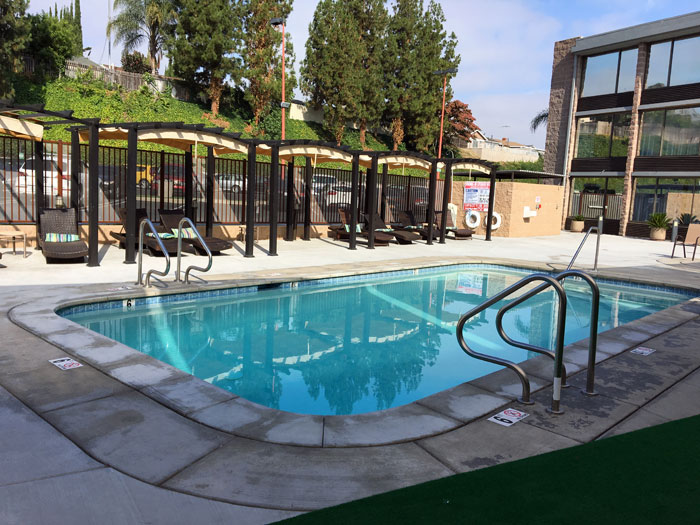 Pool area and shaded cabanas at The Hills Hotel in Laguna Hills, CA.