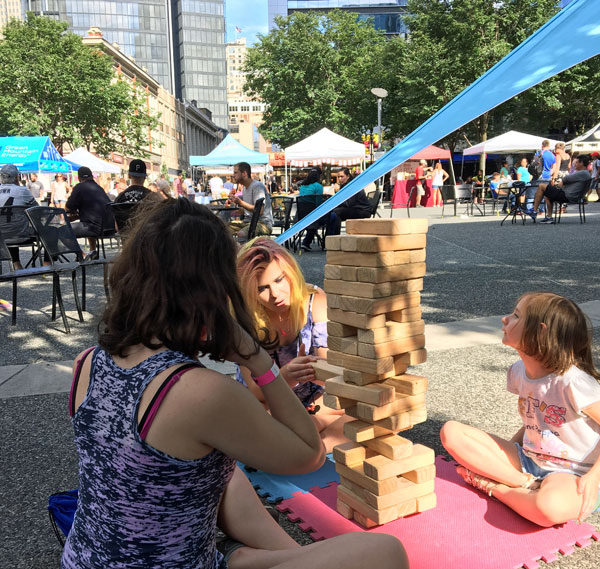 Playing giant Jenga in Market Square in Pittsburgh, PA.