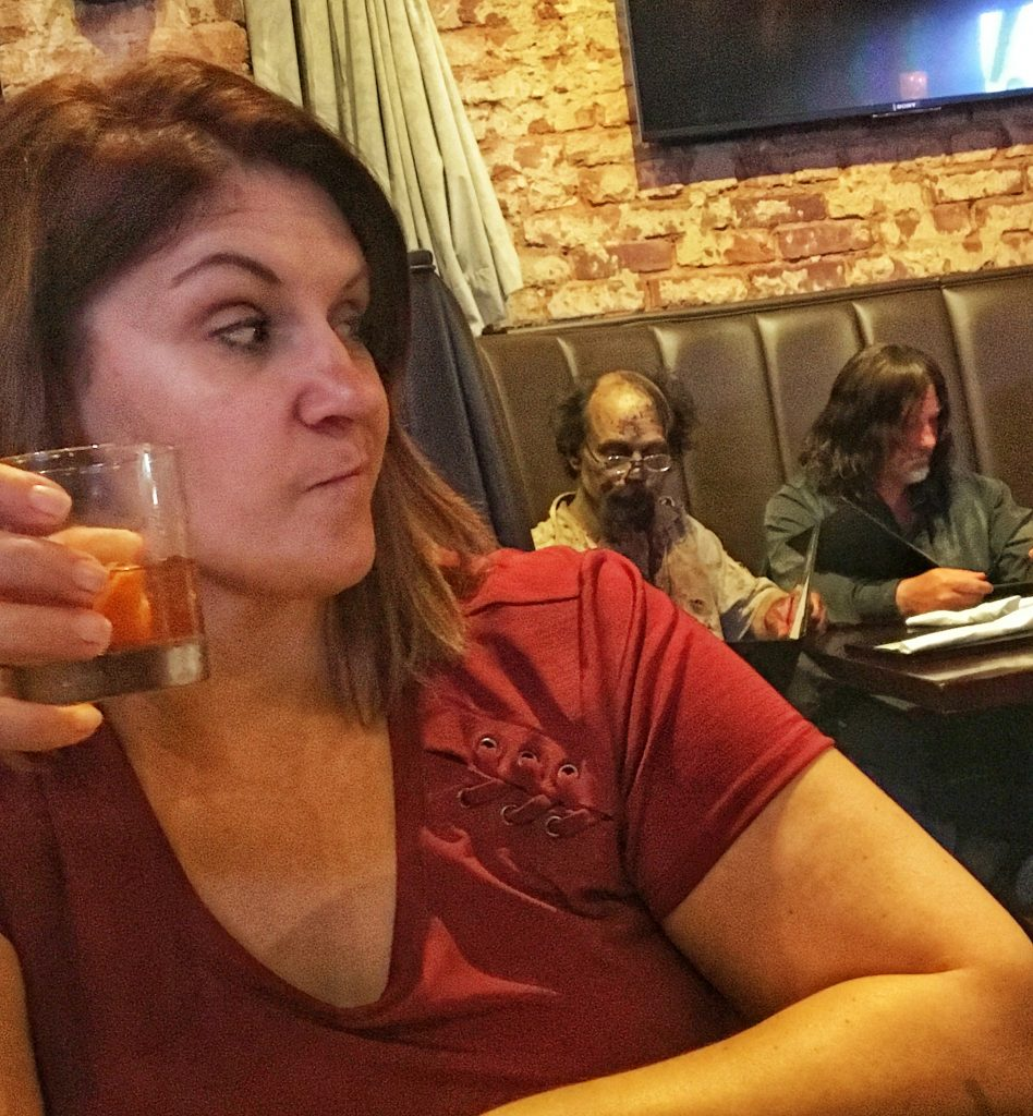 Eating dinner with zombies behind me.