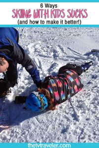 girl lying on ski slope