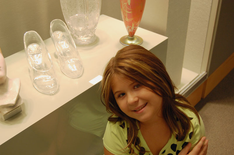 girl with glass slippers at museum